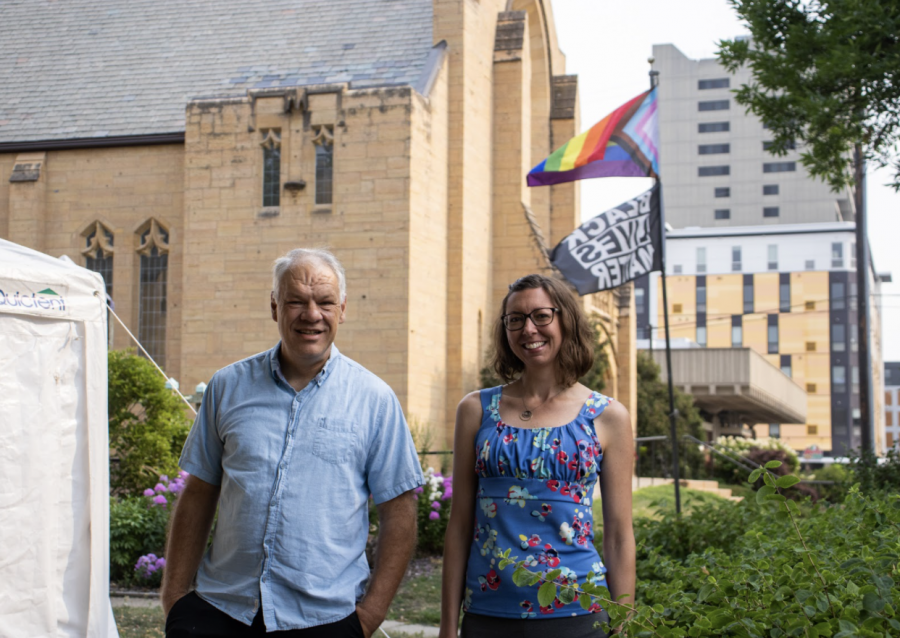 Pastor of the University Baptist Church Doug Donley and Executive Director of the Southeast Como Improvement Association Jessica Focht-Perlberg pose in front of the church on July 21, 2021. Focht-Perlberg and Donley organized a Drop-in Day at the church offering free hot meals, haircuts and supplies to the unhoused community in Dinkytown.