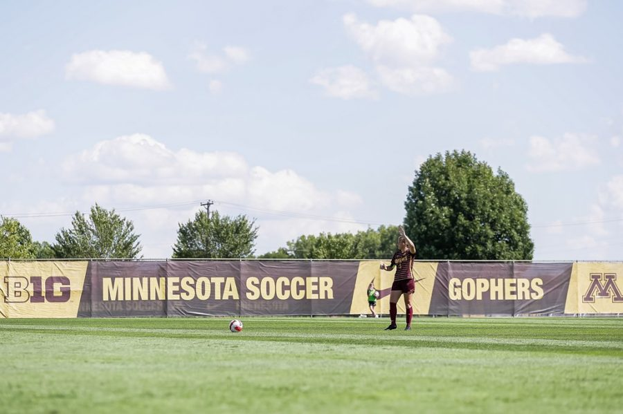 Senior captain center back Delaney Stekr raises her arm as she prepares to take a free-kick for the Gophers in a match earlier this season against the University of Wyoming on Sunday, Sept. 5, 2021, at Elizabeth Lyle Robbie Stadium in Falcon Heights, Minn.