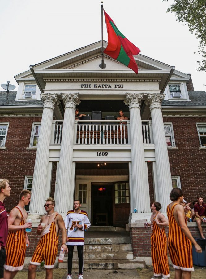 Phi Kappa Psi fraternity members stand outside of their house tailgating prior to the Minnesota football game on  Saturday, Sept. 11. The 2021-22 school year has seen the revival of fraternities tailgating before football games.