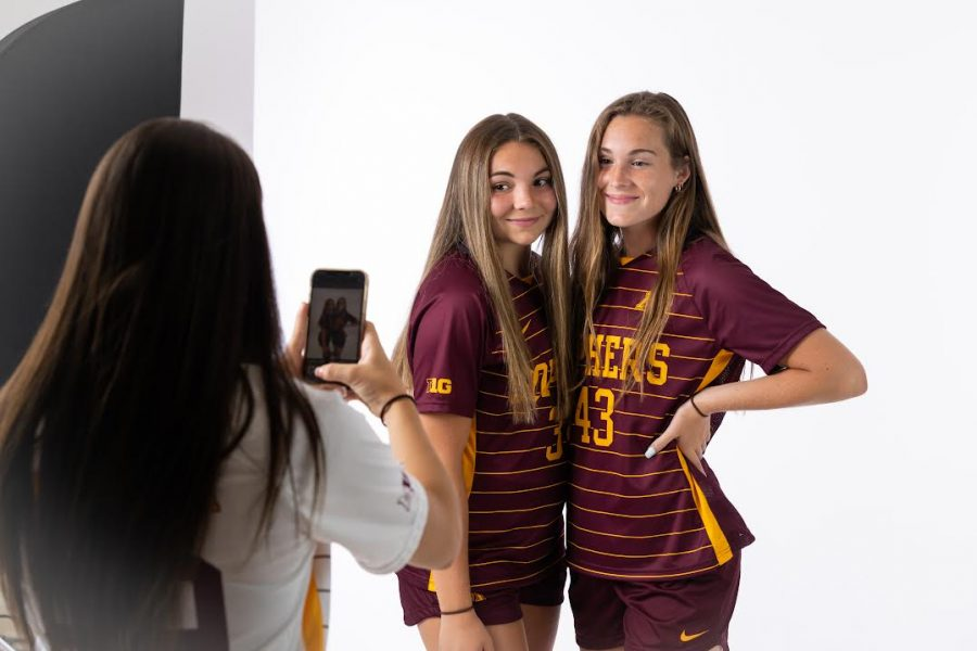 Khyah and Sadie Harper pose for a picture in their Gophers soccer uniforms.
