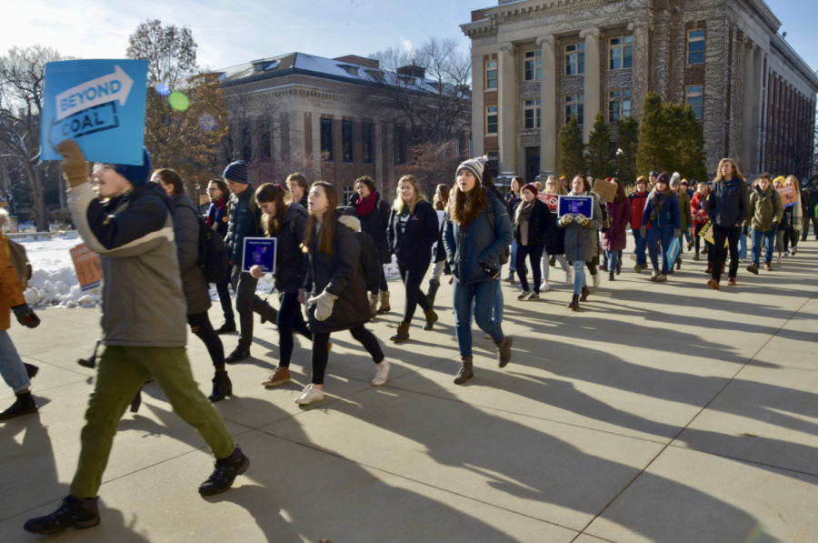 Students+and+faculty+march+towards+Morrill+Hall+as+part+of+the+UMN+Climate+Strike+on+Friday%2C+Dec.+6%2C+2019.+Those+in+attendance+criticized+the+University%E2%80%99s+policies+on+fossil+fuel+usage.