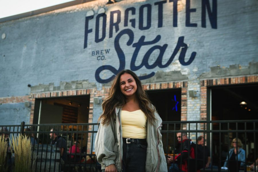 Artist+Allison+Hunsley+poses+in+front+of+the+logo+she+painted+for+Forgotten+Star+Brewing+Company+on+Tuesday%2C+Oct.+5.+Hunsley+also+painted+a+mural+alongside+the+back+wall+of+the+brewery.